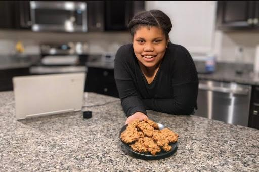 A Healthy Habits Teen Ambassador shows off a plate of oatmeal breakfast cookies, which she helped bake during a virtual cooking demonstration.