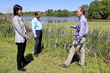 Dr. Michael Eggleton discusses wetlands restoration with Drs. Yingkai Fang and Uttam Deb at a wetland adjacent to the UAPB campus.