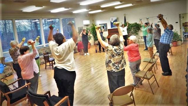 Participants in the LIFT program at the Troy-Montgomery County Senior Center kick off their class with strength building exercises using hand-held weights.