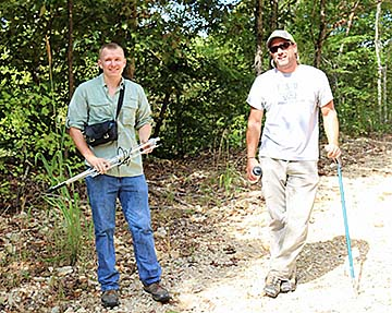 Dr. Bill Sutton and his student, Shawn Snyder, spend the day in the Tennessee woods collecting data on the threatened Western pygmy rattlesnake.