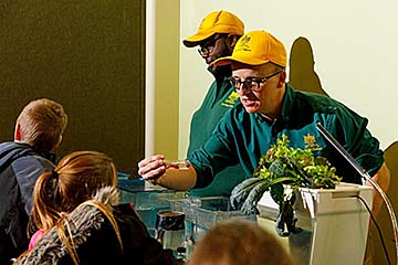 Dr. Ken Thompson provides a hands-on aquaculture activity for students at an Extension event.