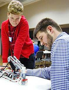 Walter Malone, Extension agent III for Sullivan County in Tennessee, works with a student during a meeting of the teen tech club conducted in partnership with local public libraries.