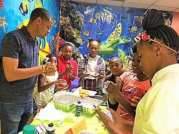 Kevin McGhee, 4-H regional educator, works with a group of students.