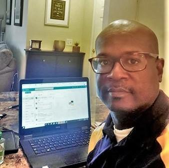 Phillip Petway, FVSU Twiggs County 4-H Extension agent, sits in front of his laptop, which he uses to provide programs to youth in his service area.